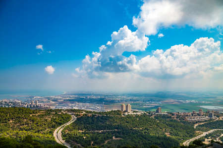 Panoramic view of the bay of Haifa, with downtown Haifa, the harbor, the industrial zone in a sunny summer day. Viewed from Haifa University. Haifa, Northern Israel Фото со стока