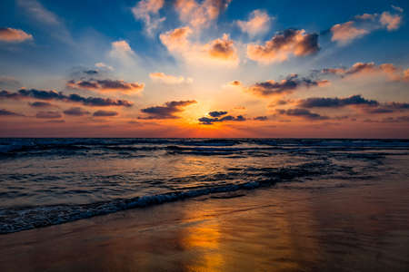 Beautiful amazing sunset over the mediterranean sea. Rays of the sun through the clouds