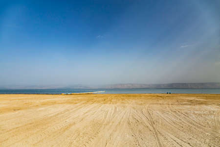 View of the sea of Galilee (Lake Tiberias, Kinneret or Kinnereth), beach with tire tracks. The lowest freshwater lake on Earth. Israel.