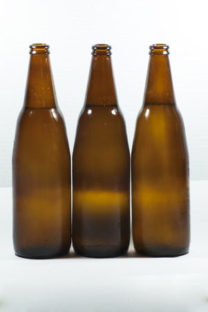 dew cap: Bottle of beer with drops on white background Stock Photo