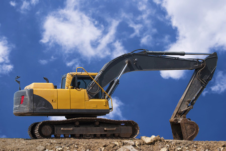 dumper truck: construction site digger, excavator and dumper truck. industrial machinery on building site Stock Photo