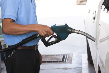 natural gas prices: Pump nozzles in gas station Stock Photo