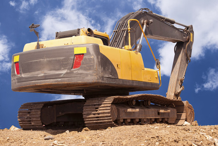 construction site digger, excavator and dumper truck. industrial machinery on building site Stock Photo