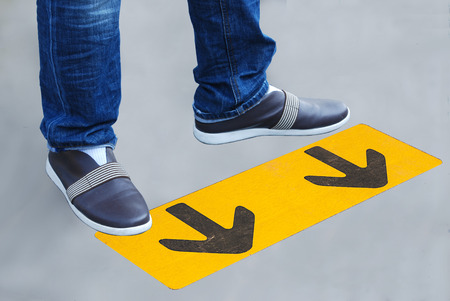 foot path: a man standing on the road. the road arrow Stock Photo