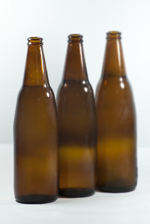 unbottled: Cold 3 beer bottles on a white background Stock Photo