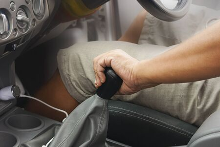shift: close up of hand on manual gear shift knob