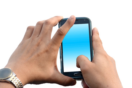 A man hands holding a smart phone with a blank screen that splits over a white background.