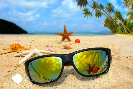 Sun glasses and starfish on the beach
