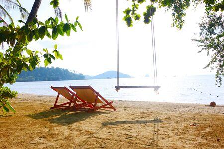 Beach chairs on perfect tropical sand beach