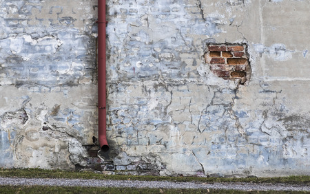 crack pipe: Old decayed wall Stock Photo