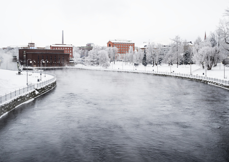 TAMPERE, FINLAND - JAN 2016. Cold winter day next to Tammerkoski. Temperature were below -20 degrees.