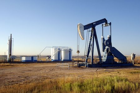 drilling well: Oil well and storage tanks in the Texas Panhandle. Stock Photo