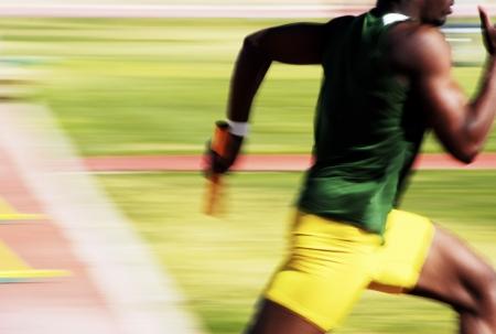 Nummer 4 runner in de 4x100 relay race. Stockfoto