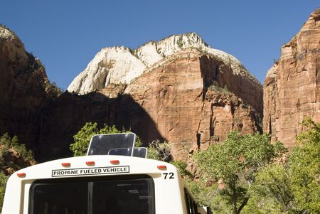 fueled: A porpane fueled shuttle bus in Zion National Park in southwest Utah. Sandstone formations in the background.
