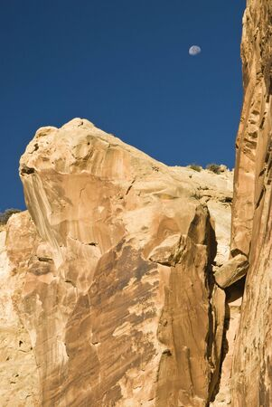 ut: view of the moon and canyon walls along the Grand Wash trail in Capital Reef National Park