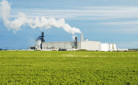 Ethanol production plant utilizing corn as a feed stock located in the middle of farm land in the Dakotas.