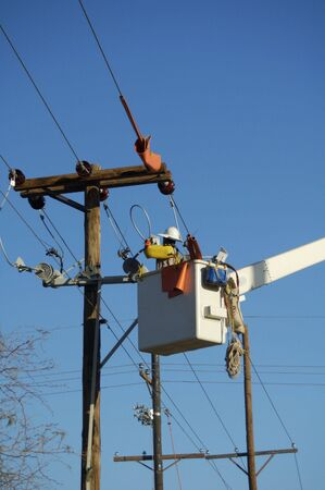 lineman: Electric utility lineman working on power lines. Stock Photo