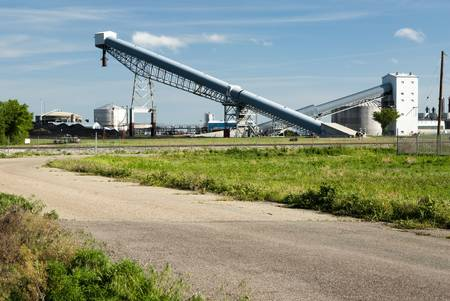 coal fired: conveyor equipment at a coal fired power plant for producing electricity