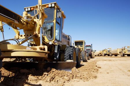 buildingsite: Heavy construction equipment on a construction site.