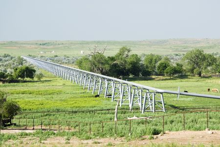 A gas pipeline crossing a river valley in the Texas Panhandle