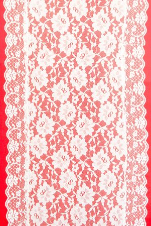white lace with a red background