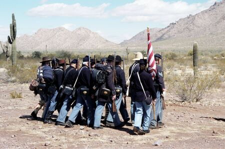 troops marching in a civil war reenactment at Picacho Peak State Park, Arizona photo