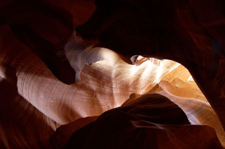 stratification: Light reflects from the sandstone walls of a slot canyon in Arizona. Stock Photo