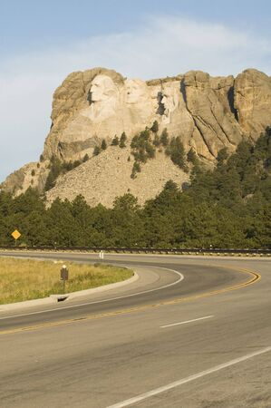 honest abe: Early morning view of Mount Rushmore National Monument from a highway in the Black Hills of South Dakota. Editorial