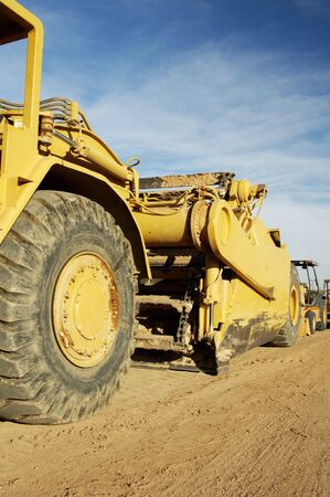buildingsite: Heavy construction equipment parked on a residential construction site in Arizona.