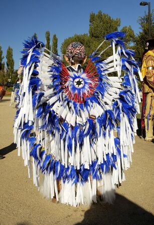 powwow: Native American costume on display during a parade. Stock Photo