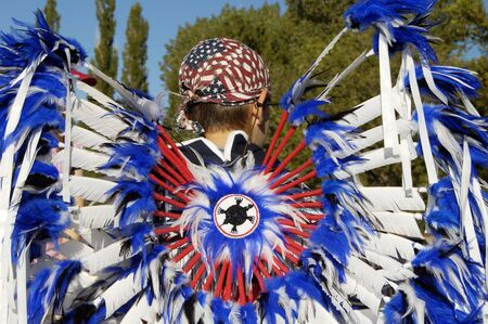 pageant: Native American costume on display during a parade. Stock Photo