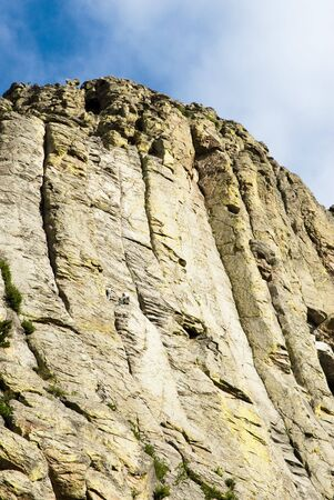 crack climbing: Rock climbers on  Devils Tower National Monument in Wyoming Stock Photo