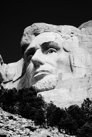the head of Abraham Lincoln on Mount Rushmore National Memorial in black and white