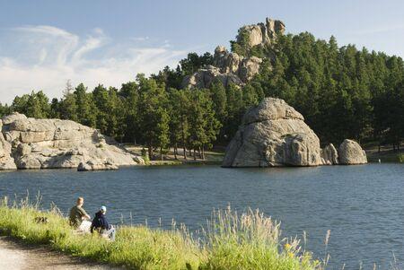 a couple fishing at Sylvan Lake in the Black Hills of South Dakota. Summer 2007 Reklamní fotografie