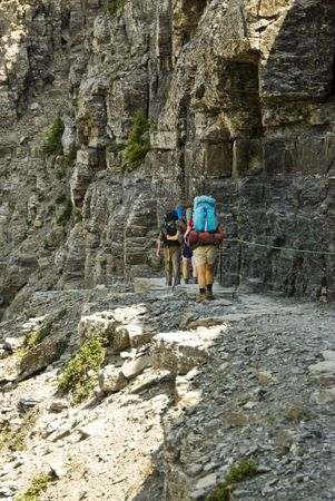 backpackers on the Highline Trail in Glacier National Park