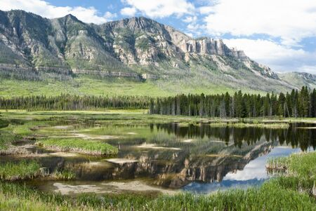 cody: reflections in a lake along Chief Joseph Scenic Byway in Wyoming.
