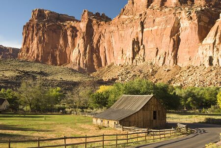 buttresses: view of sandstone formations and Gifford farm along the scenic drive in Capital Reef National Park Stock Photo