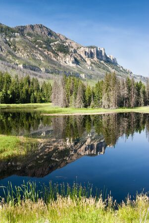 reflections in a lake along Chief Joseph Scenic Byway in Wyoming.