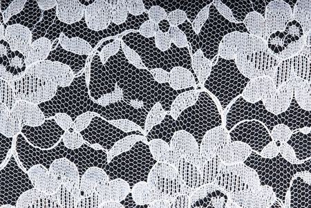 white lace on a black background photo