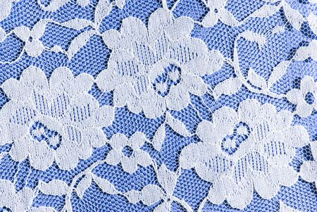 patterns in white lace on a blue background