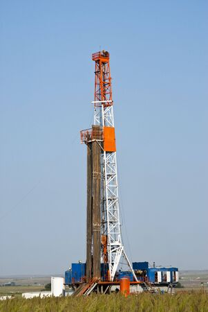 oilfield: an oil well drilling rig in Texas