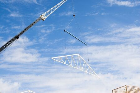 roof trusses being put in place at a construction site