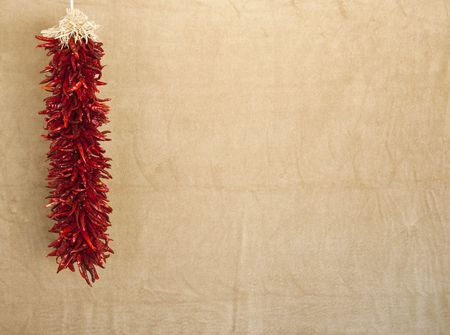 hanging red chile ristra with textured space for text or design elements