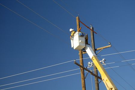 Electric utility lineman working on power lines. photo
