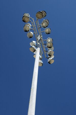 floodlights: Electric floodlights at a neighgorhood sports field.