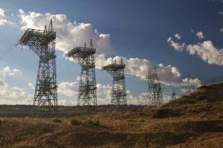 Large transmission towers carry the high voltage lines from a hydroelectric power station.