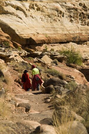Visitors hike along the trail to Hickman Bridge in Capital Reef National Park in southern Utah.