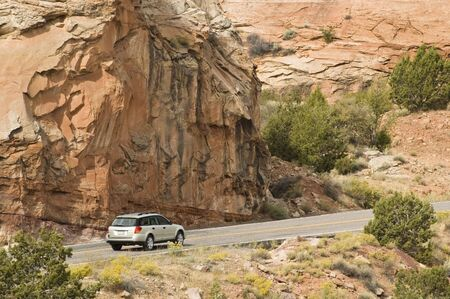 a tourist travels the scenic byway along the Fremont River valley in Capital Reef National Park.  Reklamní fotografie