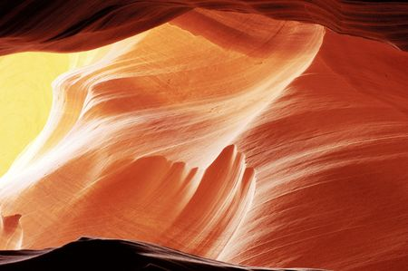 Light reflects from the sandstone walls of a slot canyon in Arizona. Reklamní fotografie
