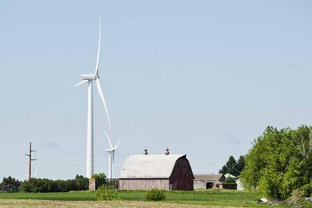 wind turbines located on farmland near Lake Benton Minnesota with transmission lines in the background Reklamní fotografie